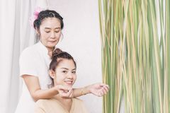 Young woman getting shoulder and neck massage in Thai spa Royalty Free Stock Photo