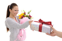 Young women with gift and flowers Royalty Free Stock Image