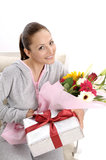 Young women with gift and flowers Royalty Free Stock Photography