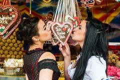 Young women with gingerbread hearts on Oktoberfest Stock Images
