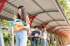 Young woman girl, student hold note book at college Stock Images