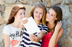 Young women girlfriends and tablet pc computer Royalty Free Stock Photo