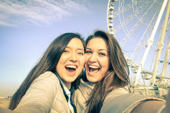 Young women girlfriends taking a selfie at luna park Royalty Free Stock Photography