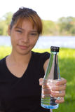 Young women give the bottle of drinking water Royalty Free Stock Images