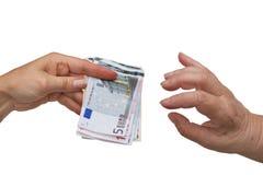Young women gives money  to senior citizen Stock Photo