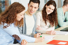 Woman giving private lessons. Young women giving private lessons to school students Stock Photography