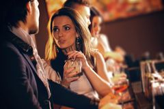 Young Woman in Conversation with a Guy at the Bar Royalty Free Stock Photos