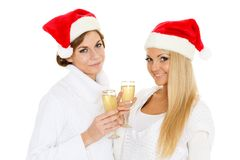 Young women  with glasses of champagne. Christmas. Stock Photography