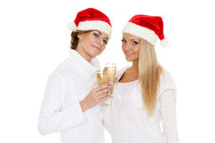 Young women  with glasses of champagne. Christmas. Stock Image