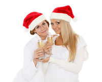 Young women  with glasses of champagne. Christmas. Stock Photos
