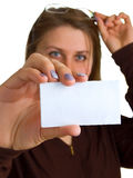 Young women in glasses shows empty white card Stock Images