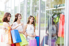 Young Women group Carrying Shopping Bags Royalty Free Stock Photography