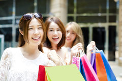 Young Women group Carrying Shopping Bags On Street Royalty Free Stock Images