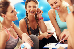 Young women group discussing health plan at the gym. Picture showing young women group discussing workout plan at the gym Royalty Free Stock Image