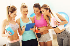 Young women group discussing health plan at the gym stock photos