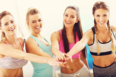 Young women group gicing high five at the gym after workout Royalty Free Stock Images