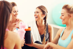 Young women group resting at the gym after workout. Picture showing young women group resting at the gym after workout Royalty Free Stock Photography