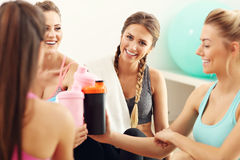 Young women group resting at the gym after workout. Picture showing young women group resting at the gym after workout Stock Image