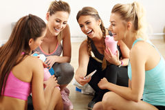 Young women group resting at the gym after workout. Picture showing young women group resting at the gym after workout Stock Photos