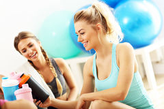 Young women group resting at the gym after workout. Picture showing young women group resting at the gym after workout Stock Photo