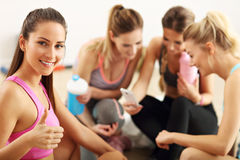 Young women group resting at the gym after workout. Picture showing young women group resting at the gym after workout Royalty Free Stock Image