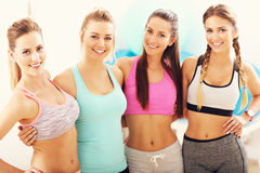 Young women group resting at the gym after workout. Picture showing young women group resting at the gym after workout Royalty Free Stock Images
