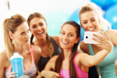 Young women group taking selfie at the gym after workout. Picture showing young women group taking selfie at the gym after workout Stock Photo