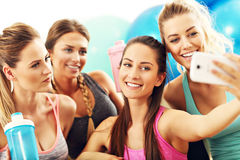 Young women group taking selfie at the gym after workout. Picture showing young women group taking selfie at the gym after workout Royalty Free Stock Photos