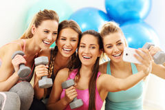 Young women group taking selfie at the gym after workout. Picture showing young women group taking selfie at the gym after workout Stock Images