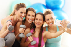 Young women group taking selfie at the gym after workout Royalty Free Stock Images