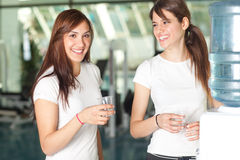 Young women in the gym drinking water Royalty Free Stock Image