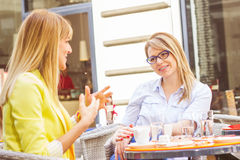 Young Women have Coffee Break Together Stock Photography