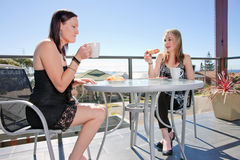 Young women having breakfast in cafe Stock Photo