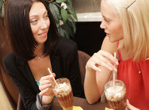 Young women having coffee break together Royalty Free Stock Image