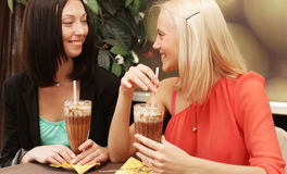 Young women having coffee break together Royalty Free Stock Images