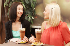 Young women having coffee break together Stock Photo