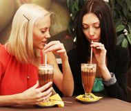 Young women having coffee break together Stock Image