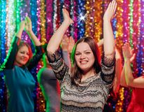 Dance girls holidays party. Young women having dance party in night club Stock Photography