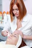 Woman having facial beauty treatment royalty free stock photo