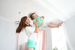 Young woman having fun with daughter Royalty Free Stock Photo