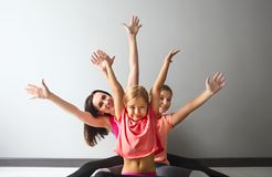 Young woman having fun with kids. Young women having fun with kids after yoga stock photography