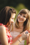 Young women having fun looking at photos on digital camera Stock Image