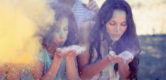 Young women having fun with powder paint Royalty Free Stock Photos