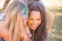 Young women having fun with powder paint Stock Photos