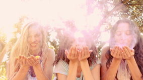 Young women having fun with powder paint Stock Footage