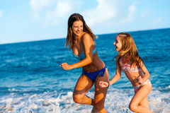 Young women having great time on beach. Royalty Free Stock Image