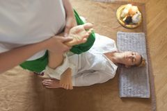 Young woman having massage treatment Stock Images