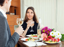 Young women having romantic dinner with her husband Stock Photography