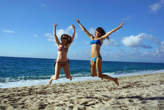Young women high jump on a beach Royalty Free Stock Image
