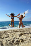 Young women high jump on a beach Royalty Free Stock Images